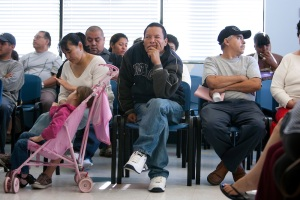 Patients wait for medical care in a crowded waiting room at South Central Family Health Center.